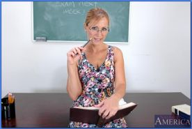 Mature teacher in glasses Nicole Moore revealing big knockers and pussy