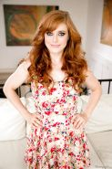 Busty redhead Penny Pax shows her big round tits & hot twat wearing heels