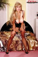 Stocking and garter clad MILF solo girl Chloe Vevrier exposing huge hooters