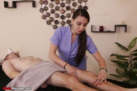 Sexy Latina masseuse delivering CBT to bound man on massage table