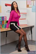 Horny milf babe Jessica Jaymes shows big round tits in empty office