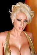 Shapely MILF in latex leotard Candy Manson posing seductively