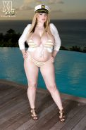 Chubby blond with fat tits in bikini Ashley Sage Ellison fervently posing outdoor
