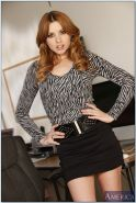 Stylish office redhead Lexi Belle showing off ass and cute little bush