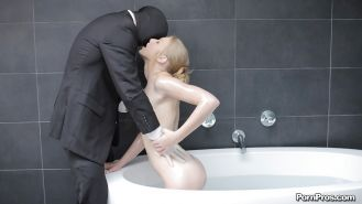 Teen blondie Avril Hall does a blowjob and handjob in a bathroom