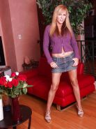 Blonde MILF Nicole Moore undressing and posing nude on the couch