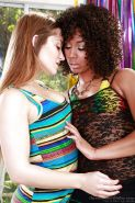 Curly-haired ebony vixen has some lesbian humping fun with her white friend