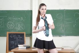 Clothed babe Connie Carter is showing off in a school uniform