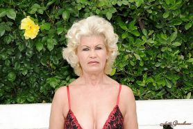 Horny blonde granny with big tits shows off her hairy cunt outdoor
