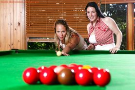 Amateur girls Angie and Indiana sink fingers into wet cunts on pool table