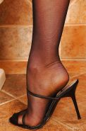 Aletta Ocean taking off her high heels and ripping off her stockings