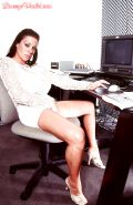 MILF solo model Linsey Dawn McKenzie revealing knockers and snatch in office
