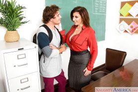 Busty MILF teacher Sara Jay seducing male student for sex on desktop