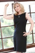 Mature lady in stockings Nina Hartley gets rid of her dress and lingerie