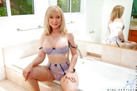 Mature Nina Hartley takes off lingerie and pays with her eager cunt