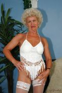 Lustful granny taking off her lingerie and exposing her shaggy muff