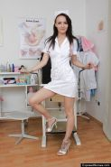 Fetish brunette nurse Belle pumping a toy in that tight pussy