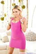 Tattooed blonde solo girl Marsha May freeing large boobs from tight dress