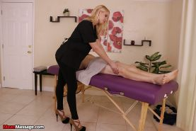 Blonde Mistress in yoga pants delivers handjob to bound submissive man