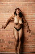 Black mature Semmie Desuora fondling her juggs and posing in panties