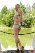 Outdoor posing session features blonde babe in high heels Lola Taylor