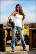 Gorgeous biker babe in jeans and boots denudes her stunning curves