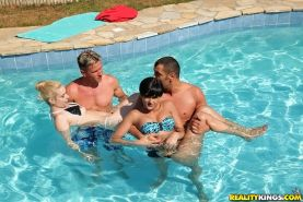 Coco Demal and her friend Nesty swimming with a handsome fellow