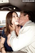 Pierced and busty MILF Kianna Dior giving blowjob in moving car