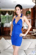 Hot Nikki Daniels looks absolutely hot and sexy in tight blue dress and high heels.