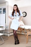 Uniformed babe Connie Carter showing off in her white nurse suit