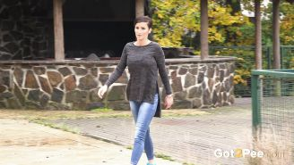 Busty Gabriellla Gucci in jeans undressing and pissing in public