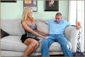 Mature seductress with fabulous tits Amber Lynn fucking on the couch