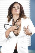 MILF babe Tory Lane sheds doctor outfit to pose in stockings and high heels