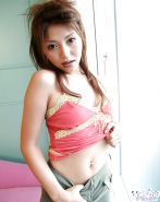 Asian babe with tiny tits and hairy cunt slipping off her clothes