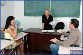Mature teacher in glasses and sexy coed sharing throbbing cock in class