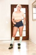 Blonde teenager Kate England posing non nude in knee high socks and shorts