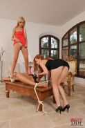 Lesbian babes tie up their girlfriend to ride a strapon and lick pussy