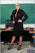 Lusty mature teacher Amber Irons showing her big tits in high heels.