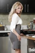 Milf blonde Jessica Drake takes off her tight skirt in the kitchen