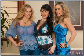 Lesbian MILFs Brandi Love, Eva Karera and Julia Ann strip together