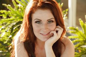 Amateur redhead Emmy Sinclair poses in bikini outdoors for sfw scenes