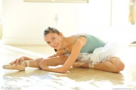Flexible young ballerina strips down and stretches her skinny body