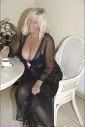 Fatty blond in fancy lingerie Sandy Spain goes to the pool to show her big tits