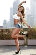 Latina bodybuilder Esperanza Gomez strips off denim shorts outdoors