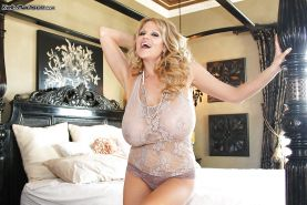 Kelly Madison is showing off her mature big tits in high heels