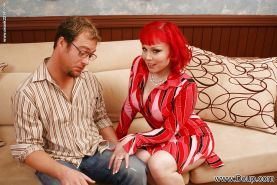 Miss Bunny is a redhead milf with big tits and a craving for fat dicks