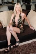 Blond MILF Emma Starr strips off miniskirt and exhibits round tits