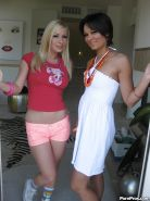 Hot babe with big tits Helena Sweet stripping and posing with her friend