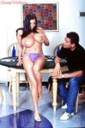 Linsey Dawn McKenzie rubs her bushy cunt in front of her man.