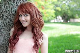 Redhead sweetie Elle Alexandra revealing her tiny curves outdoor